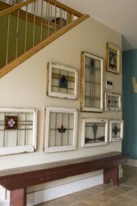 Love using framed stained glass as art fr Leah Dent Via Pinterest